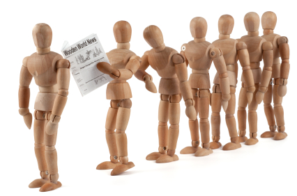 Wooden mannequins waiting in line.jpg